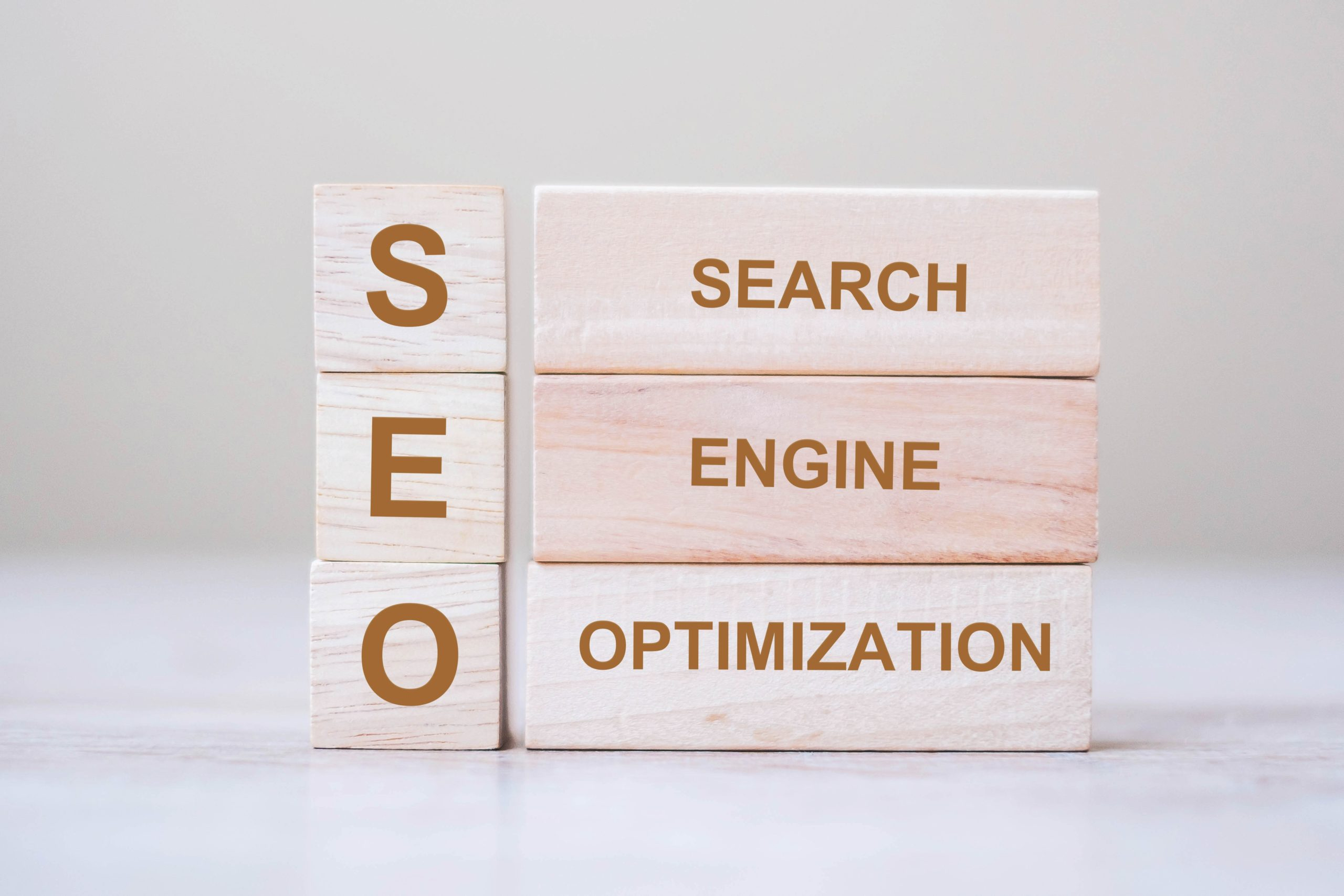 SEO (Search Engine Optimization) text wooden cube blocks on tabl